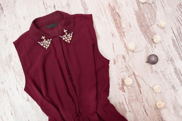 Bordeaux dress, rhinestones on the collar. Premium Photo