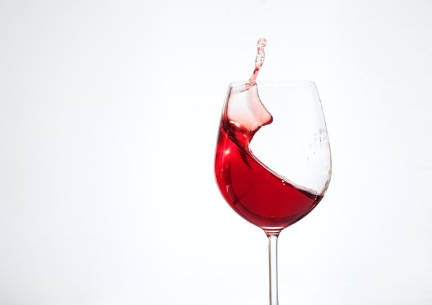 Bordeaux wine in the glass on a white background. the concept of beverages and alcohol. Premium Photo