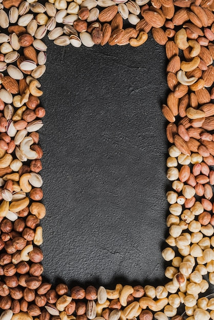 Border from various nuts Premium Photo
