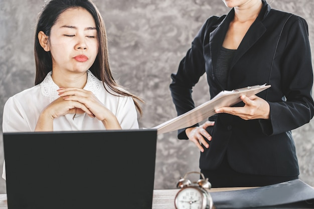 Bored female asian employee ignore annoying boss Premium Photo