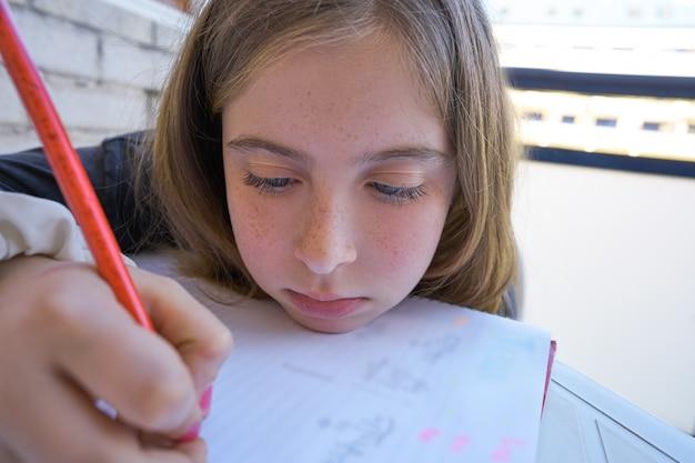 Bored student girl doing her homework Premium Photo