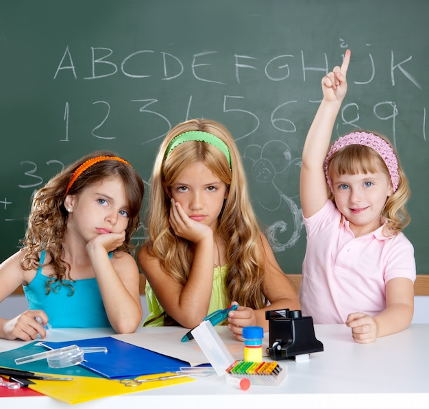 Boring sad student with clever children girl raising hand Premium Photo