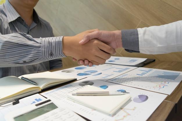 Both businessmen have achieved business success twice as profitable. Premium Photo