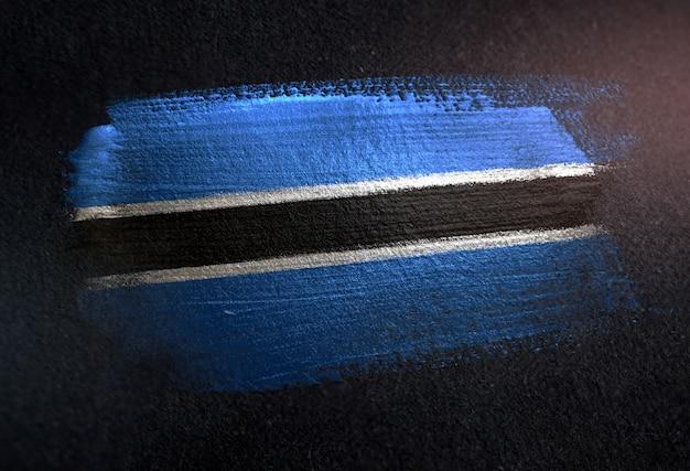 Botswana flag made of metallic brush paint on grunge dark wall Photo