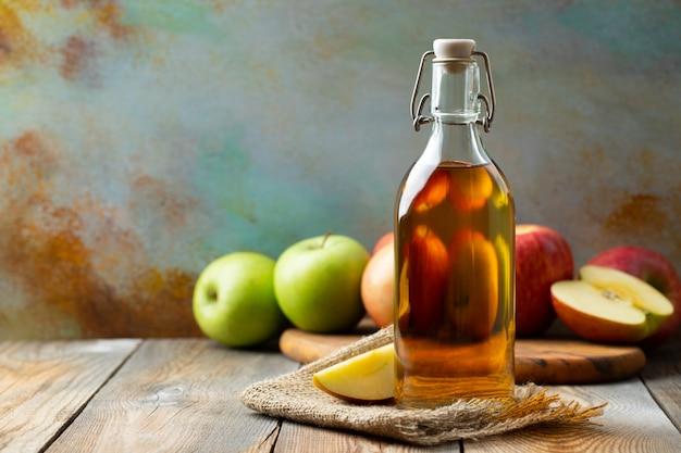 Bottle of apple organic vinegar or cider. Premium Photo