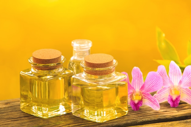 Bottle of aroma essential oil or spa on wooden table, Premium Photo