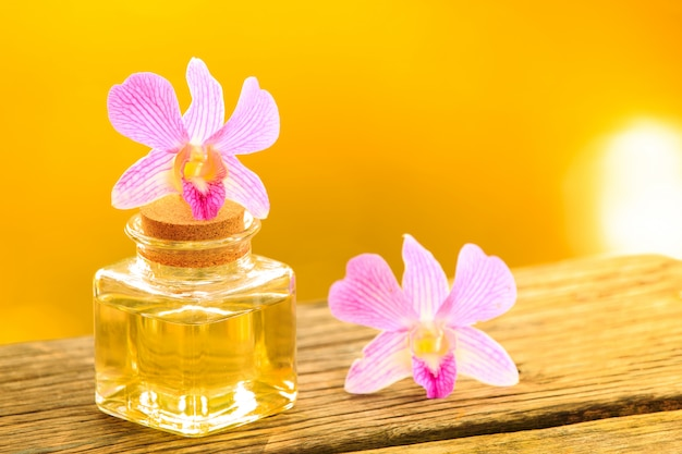 Bottle of aroma essential oil or spa on wooden table Premium Photo