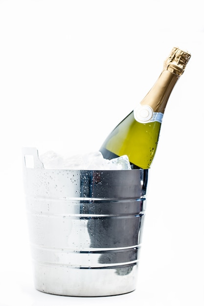 Bottle of champagne chilling in ice bucket Premium Photo