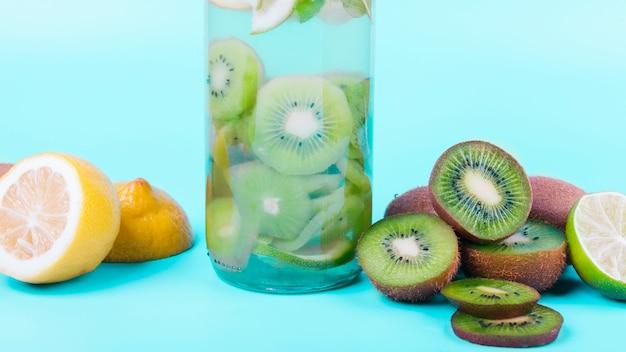 Bottle of drink with kiwi and lemon Free Photo