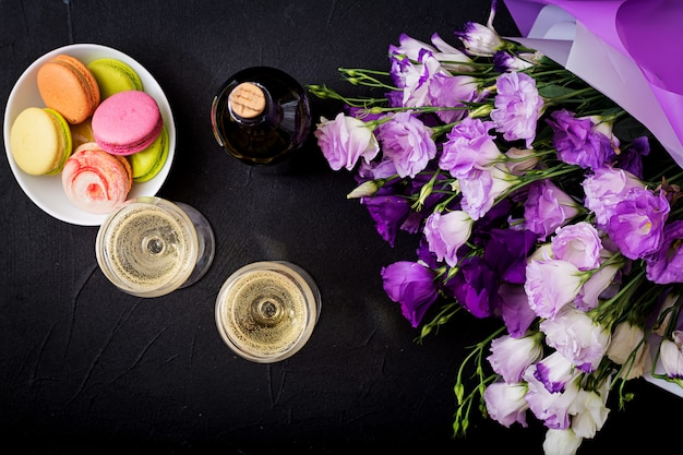 Bottle of dry white wine and a macaroon. flat lay. top view. Free Photo