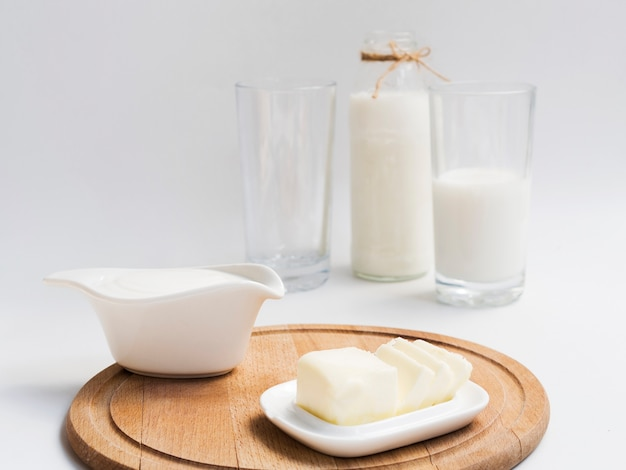 Bottle and glass of milk with butter Free Photo