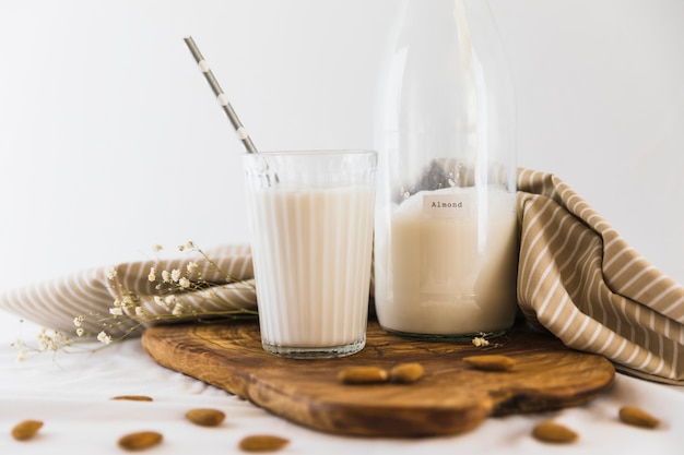 Bottle and glass of milk with nuts Free Photo