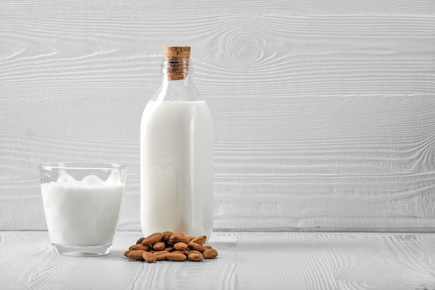 Bottle and glass with almond milk Premium Photo