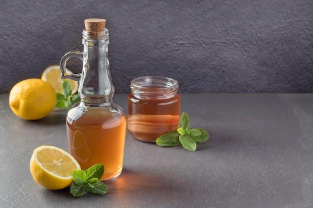 Bottle of kombucha vinegar on grey table Premium Photo