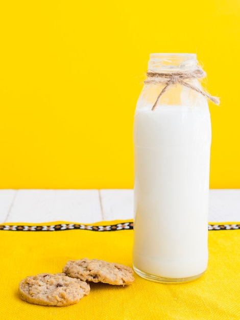 Bottle of milk and cookies Free Photo