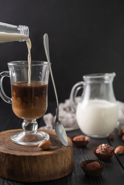 Bottle of milk and cup of coffee with truffles Free Photo