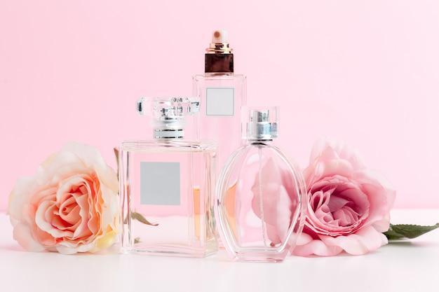 Bottle of perfume with flowers Premium Photo