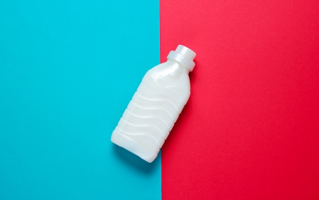 Bottle of washing gel on blue red surface Premium Photo