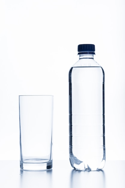 Bottle of water and glass Premium Photo