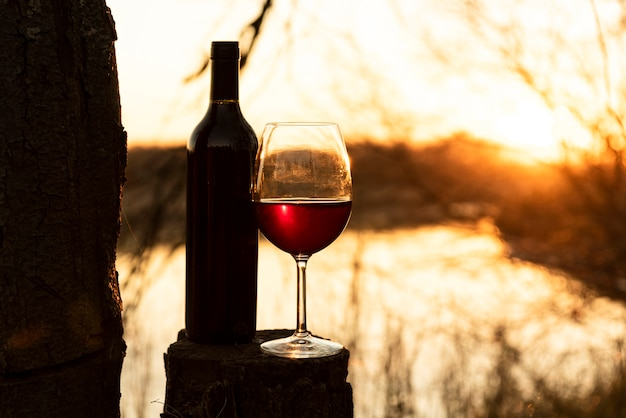 Bottle of wine and glass outdoor Free Photo