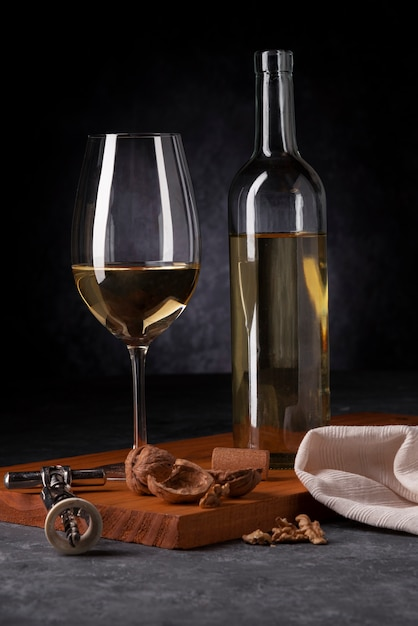 Bottle of wine and glass with opener Free Photo