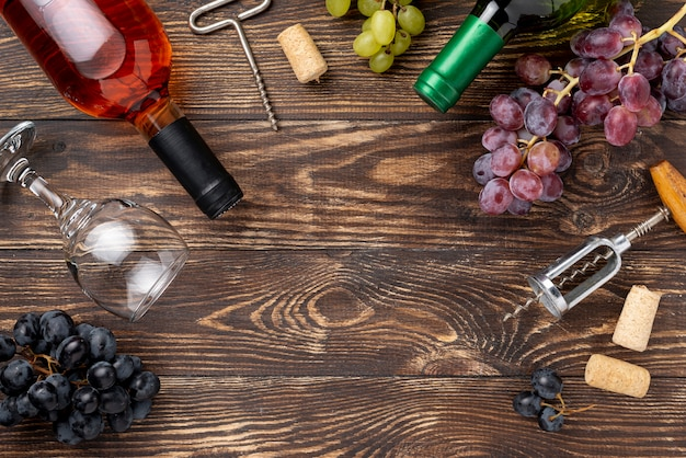 Bottle of wine, grapes and glasses on table Free Photo