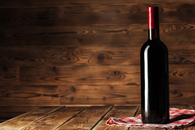 Bottle of wine over wooden background Premium Photo
