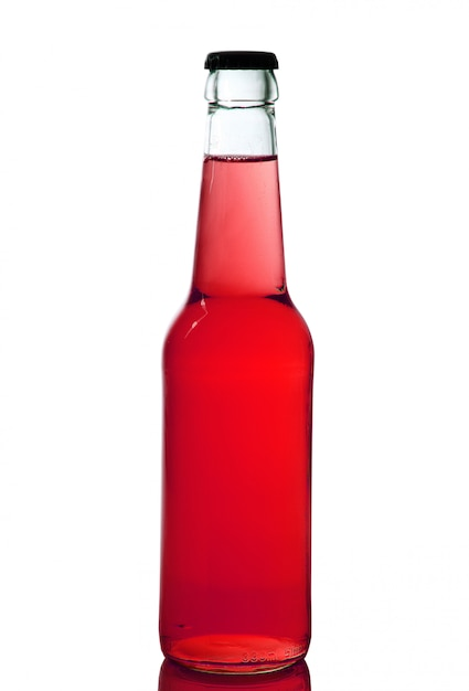 Bottle with red liquid in white background Premium Photo