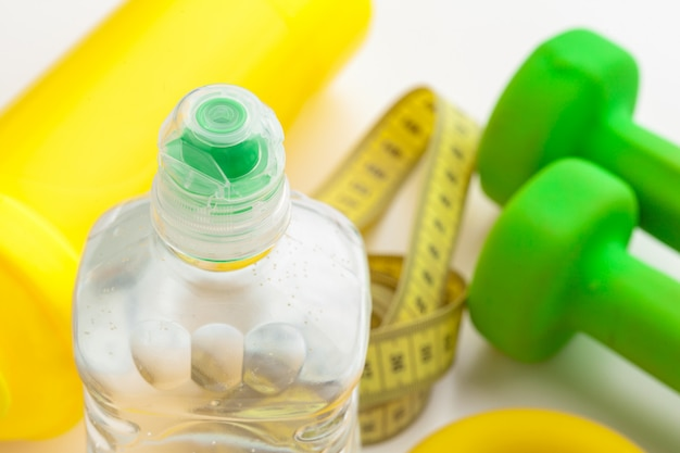 Bottled water for healthy life and measuring tape Premium Photo