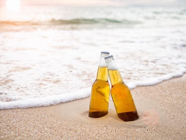 Bottles of beer on the beach Premium Photo