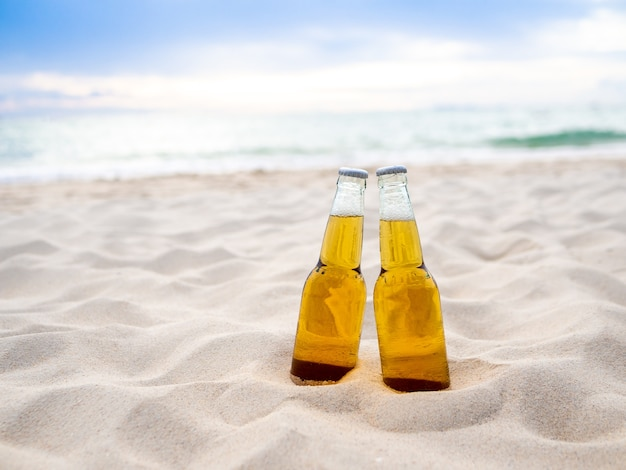 Bottles of beer on the beach Premium Photo