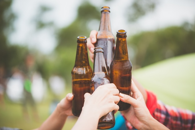 Bottles of beer.group of friends enjoying party.people are ...