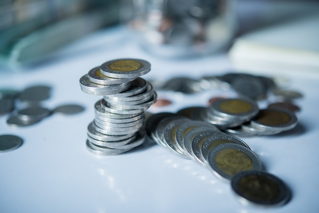 Bottles of cash with coins  in saving money concept Free Photo