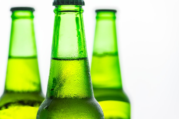 Bottles of cold beer macro photography Free Photo