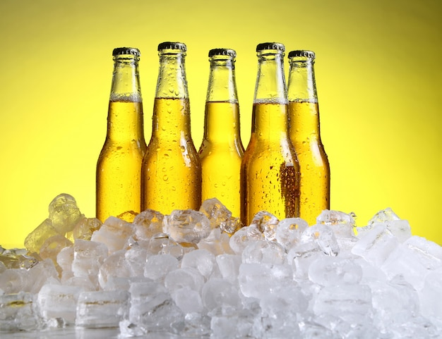 Bottles of cold and fresh beer with ice Free Photo