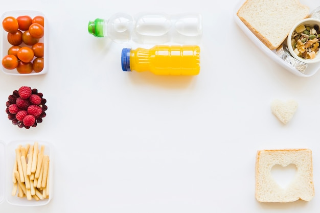 Bottles near healthy food Free Photo