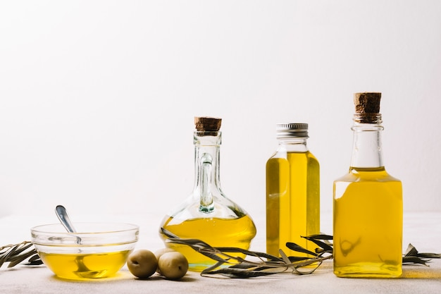 Bottles with olive oil and copy-space Free Photo