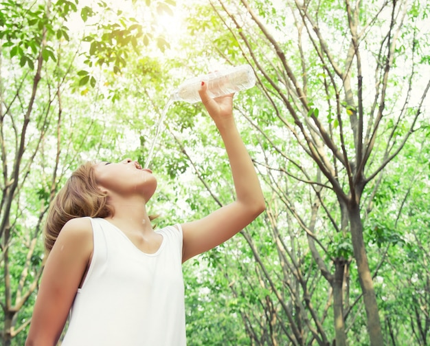 Bottom view of girl drinking water Free Photo
