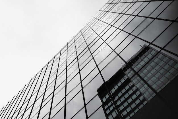 Bottom view glass building with reflection Free Photo