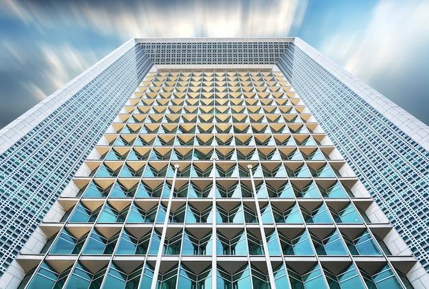 Bottom view of modern skyscraper Free Photo