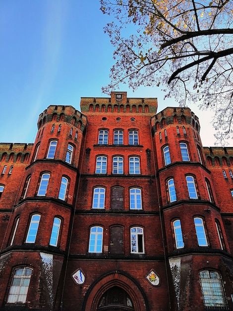 Bottom view shot of a red brick building in stargard, poland. Free Photo