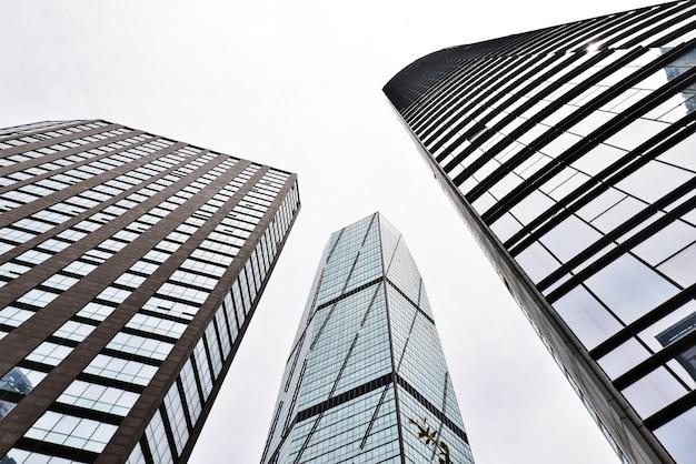 Bottom view of three buildings Free Photo