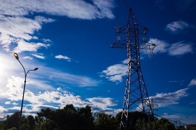 Bottom view of the tower of power grids on blue sky background, high voltage, electricity concept Premium Photo