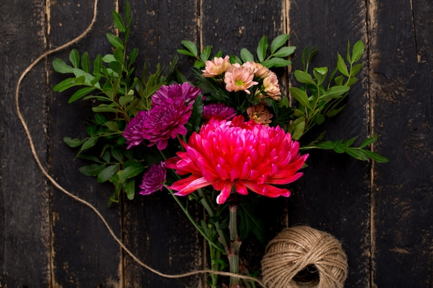 A bouquet of beautiful flowers for the holiday on wood Premium Photo
