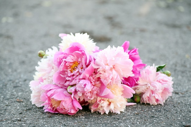 Bouquet of beautiful peonies on a road Free Photo
