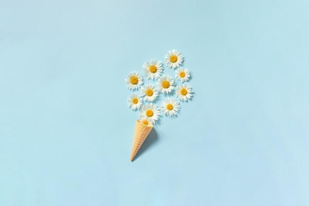 Bouquet chamomile daisies flowers in waffle ice cream cone Premium Photo