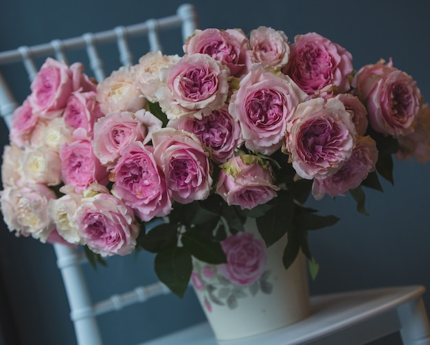 A bouquet in florish vase standing Free Photo