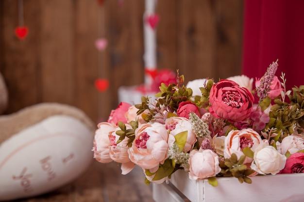Bouquet flowers artificial background, atmospheric Premium Photo