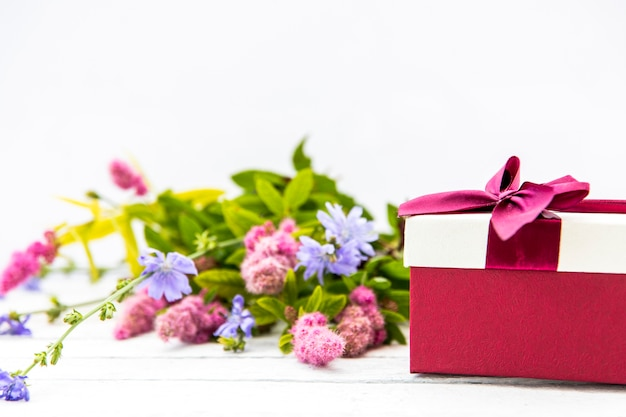 Bouquet of flowers and cute gift Free Photo