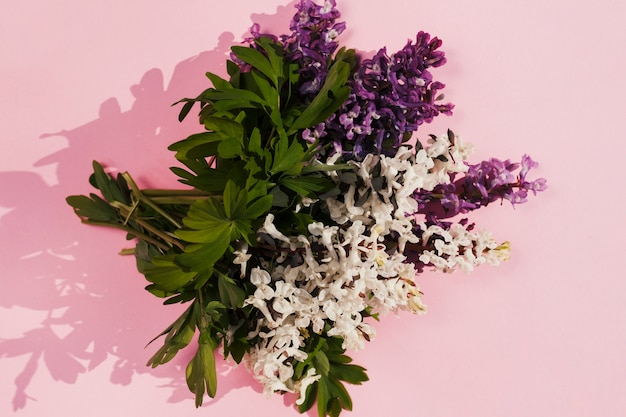 Bouquet of flowers in a pink background Free Photo